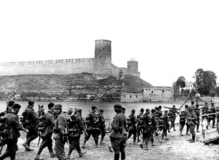 German soldiers cross the border into Russia over the river Narva from Estonia during Operation Barbarossa; the German invasion of the Soviet Union. In the background can be seen the medieval Ivangorod (Estonian: Jaanilinn) castle and fortress, pin by Paolo Marzioli