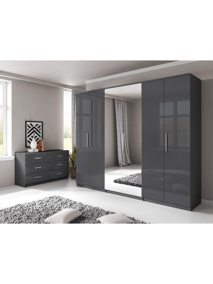 Prague Gloss 6 Door Mirrored Wardrobe Bedroom furniture with a reflective side, this large wardrobe is a new addition to the Prague gloss range - a best-selling collection in a smooth, light-luring finish - a perfect match for the mirrored centre doors that add extra depth to your bedroom.The wardrobe's exterior is finished with designer metal handles, and the inside is just as impressive...Divided into three sections, one side contains a hanging rail and high shelf, while the opposite si...