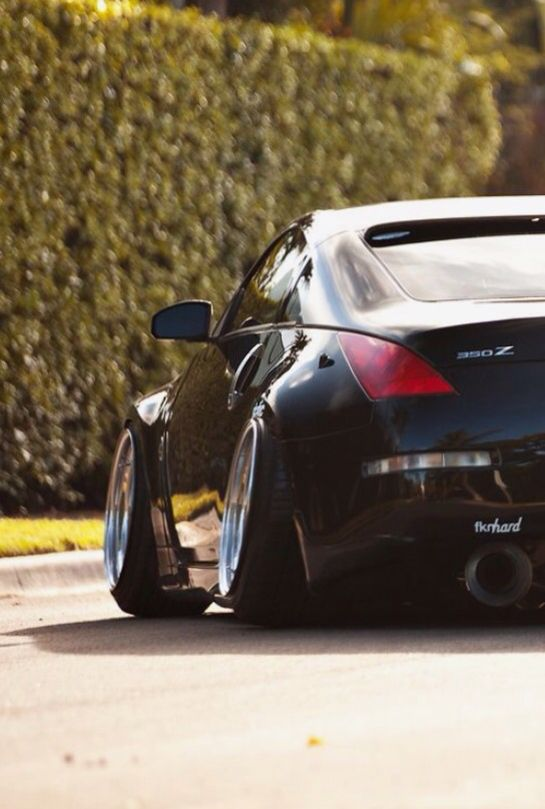Nissan 350z with a negative camber angle...makes it slammed to the floor!