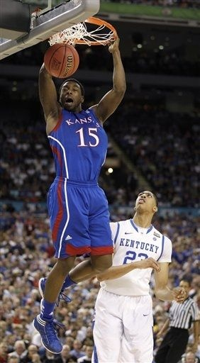 Kansas' Elijah Johnson dunks the ball over Kentucky's Anthony Davis, right, during the second half of the NCAA Final Four tournament college basketball championship game Monday, April 2, 2012, in New Orleans. (AP Photo/Mark Humphrey)