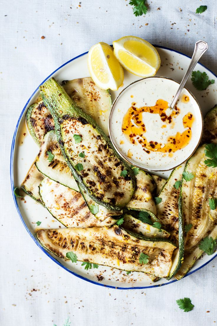 Spicy grilled zucchini with a curried dip is a simple vegan dish that makes a great vegetarian BBQ dish. Summery, dead easy to make and very versatile.