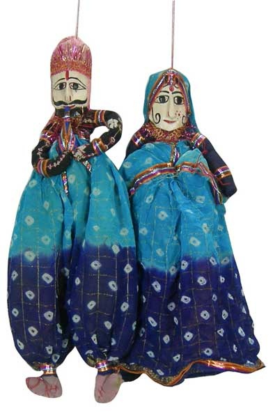 Traditional Rajasthani Puppet pair made of wood and cloth. Beautifully decorated in folk dresses. Look great hanging in my daughter's room.
