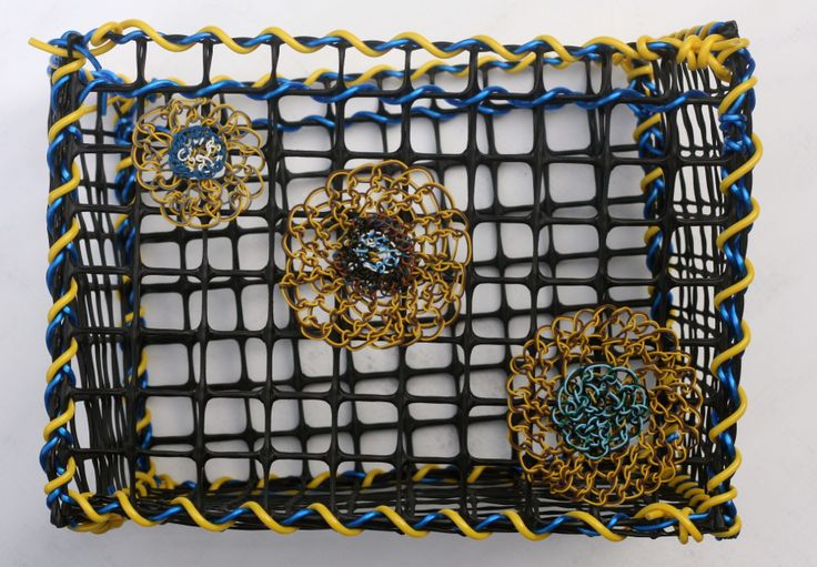 © Maritza Noa-Cabrera.   Vintage inspired, yellow and brown basket. Plastic and telephone cable wire.
