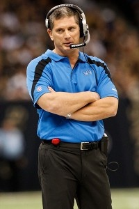 Jim Schwartz coaches with his arms folded like a man.