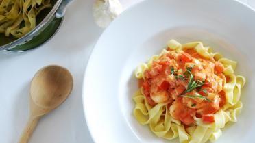 Scampi in tomatenroomsaus met pasta