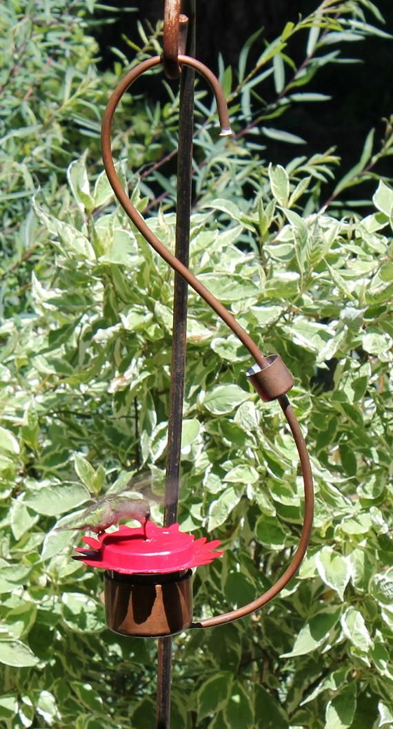 MH006 Lovely hand made hummingbird nectar feeder with built in hanger and ant moat. Made in ...