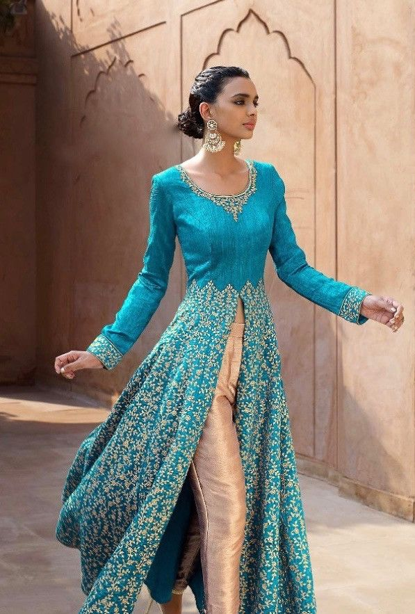 Magnify the wedding pageant by adorning this dress in blue color. This dress is designed with pristine all over floral embroidery and lace work. The dress comes with bhagalpuri top and net bottom with