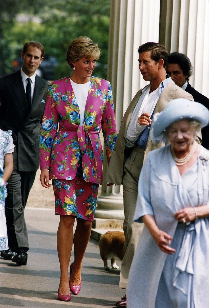 Diana wears an eye-catching suit with Princes Charles and Prince Edward and the Queen Mother in 1993
