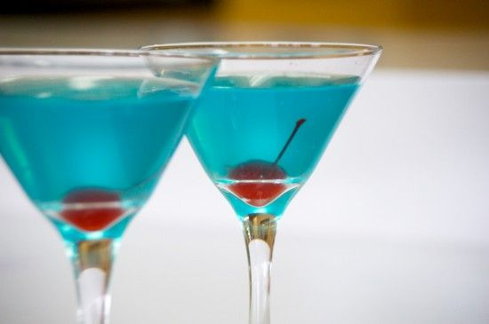 Wedding Bliss: 1 ounce Malibu Coconut Rum 1 ounce Absolut Citron ½ ounce Blue Curacao Splash of Pineapple Juice Shaken with ice Poured into a martini glass with a cherry Topped off with 7up