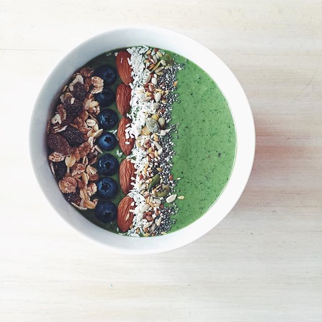 Breakfast this morning was a spinach and almond butter smoothie bowl topped with muesli, bluebs…