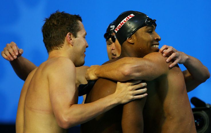 Michael Phelps Photos Photos - Michael Phelps, Cullen Jones, Neil Walker and Jason Lezak of the United States of America celebrate winning the Men's 4x100m Freestyle Relay final during the XII FINA World Championships at the Rod Laver Arena on March 25, 2007 in Melbourne, Australia. - XII FINA World Championships - Day 9