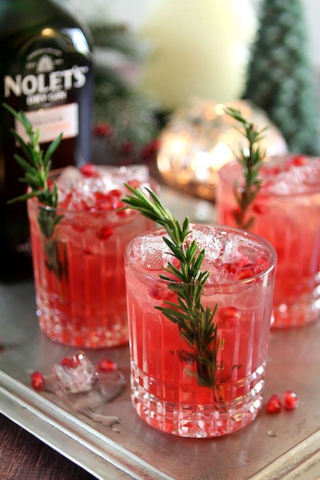 100 Christmas cocktails. Pomegranate & Rosemary Gin Fizz