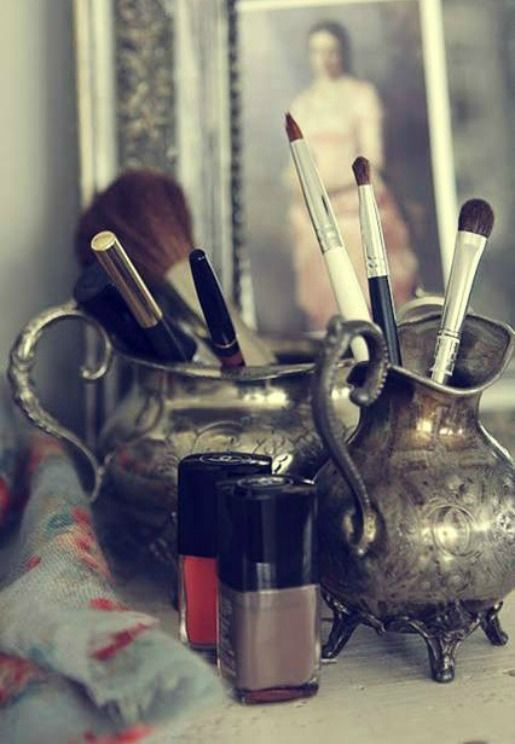 Use old silver (or glass) cups and saucers, pitchers, creamers etc to hold brushes!! Pretty to see but still useful!! Desk!