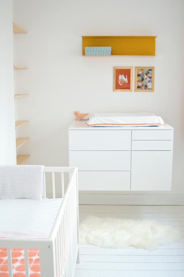 Yellow, orange & white. Scandinavian inspired nursery. Yellow Ikea Botkyrka wall unit, a Leka cat rattle and Ludde on the floor. The dresser is made with Ikea Metod kitchen cabinets #ikeanederland