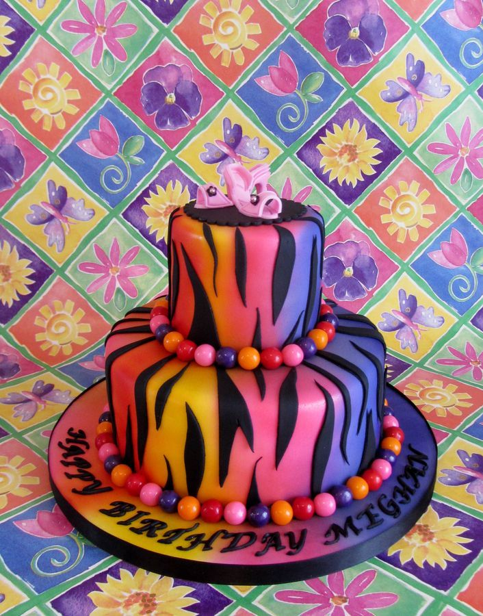 Rainbow zebra print cake... Minus the pink shoes at the top, I LOVE this cake!!