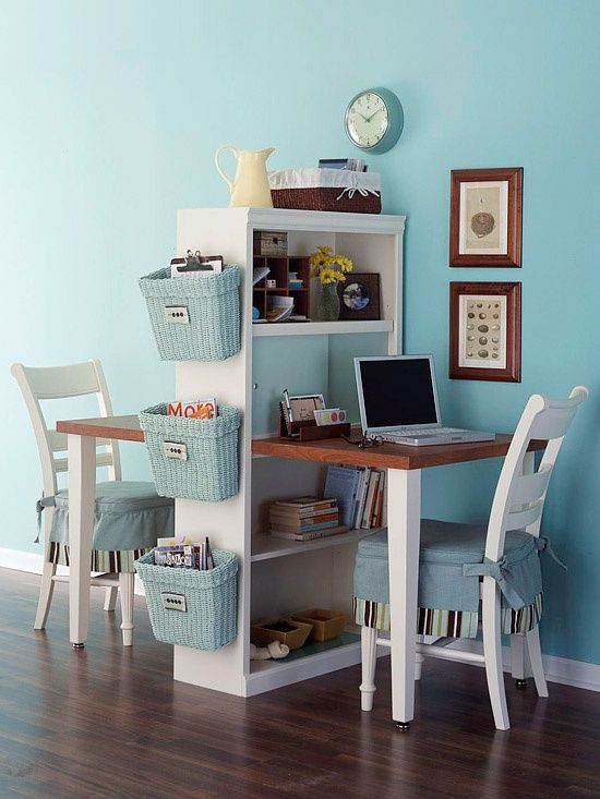Turquoise blue storage baskets make this adorable office look so nice.