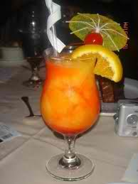 Kiss On the Lips - my favorite Carnival Cruise drink! 1 - 1 1/2 oz peach schnapps, 4-6 oz frozen mango mix, 1 tbsp grenadine syrup. Mango mix blended w/ schnapps then crushed ice. Pour grenadine in bottom of glass, filling with mango/schnapps mix.