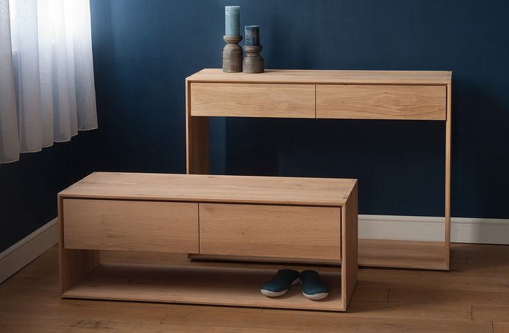 The Ethnicraft Nordic console has two drawers and can be used in a hallway for extra storage, or used as a stylish, slim dressing table or desk. Buy online.