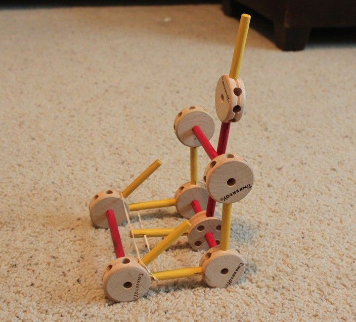 Use tinker toys to build a catapult