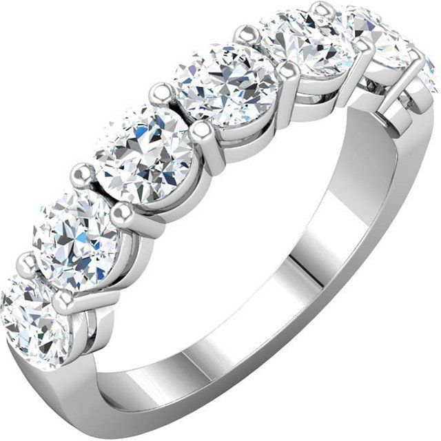 Platinum, 7 diamonds anniversary ring. Diamonds together weigh approximately 1.75ct. The diamonds are graded as G-H in color and VS in clarity.