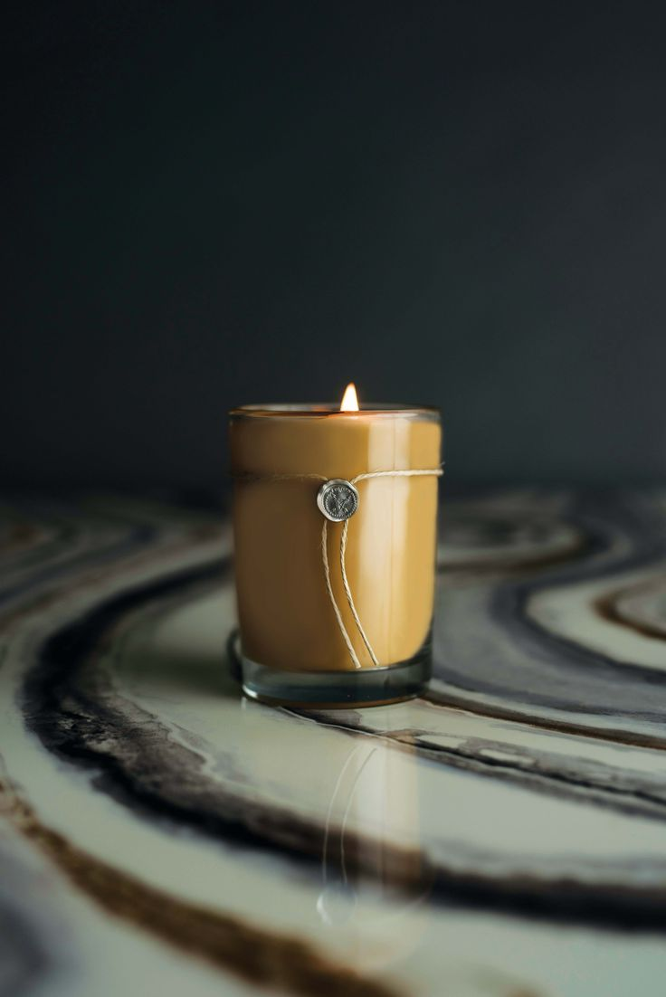 Smoked Wood & Amber Votivo candle. 6.8 oz. with a burn time up to 50-60hrs.