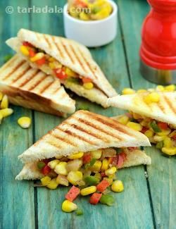 Every bite of this sandwich features an outburst of colour, crunch and flavour. An apt combination of juicy sweet corn and crispy spicy capsicum, this sandwich has a very balanced flavour, further enhanced with naturally pungent ingredients like green chillies, onion and garlic. Serve the Grilled Corn and Capsicum Sandwich fresh off the griller with tomato ketchup.