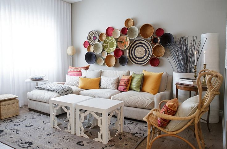 Moroccan modern room with a wall arrangement crafted from baskets 33 Moroccan Living Rooms That Bring Home An Exotic Flavor Of Vibrant Hues