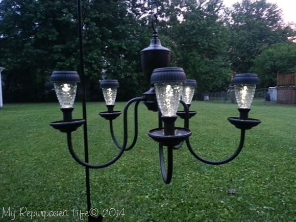 Chandelier turned into pretty and useful garden light fixtures. Repurpose that thrift store or unwanted chandelier into a new solar light.