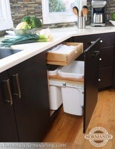 We love how this kitchen trash can is blended right in with the rest of the cabinetry! You wouldn't even know it was a drawer until you pull it open.