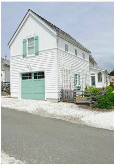 Turquoise is a fun color accent on the garage door and for Beach house look