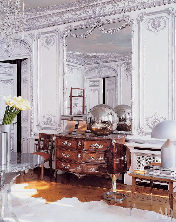 The Silver room - a chest of drawers in the Regency style, found at a flea market.  Plastic chair 1970s.  Coffee table design Gio Ponti.