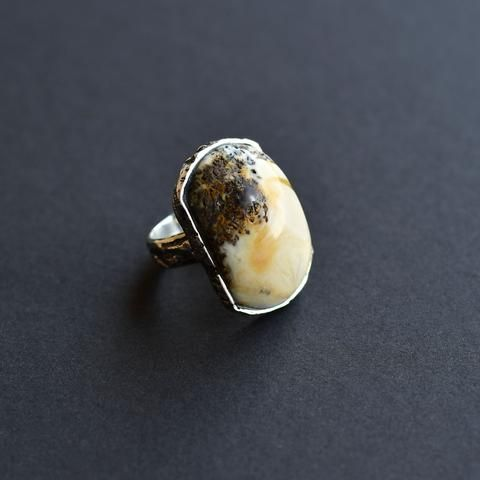 Silver ring with white and black amber