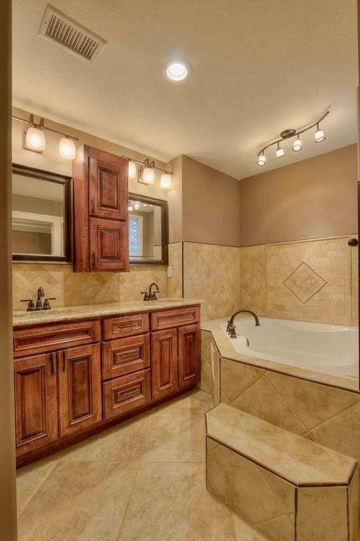 Craftsman Master Bathroom with Meta marble & granite limestone giallo atlantide honed, flush light, Double sink, Flush