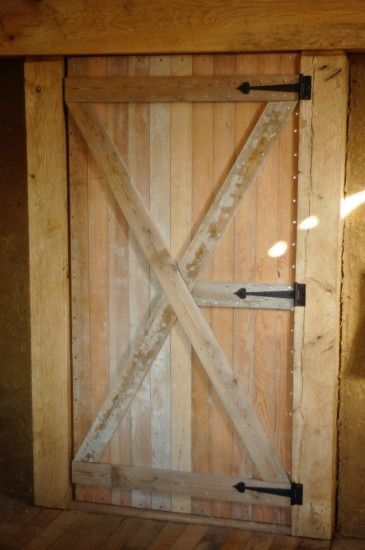 Homemade Heavy Duty Wooden Door Design.  I think I will try this on my goat barn. Thanks!