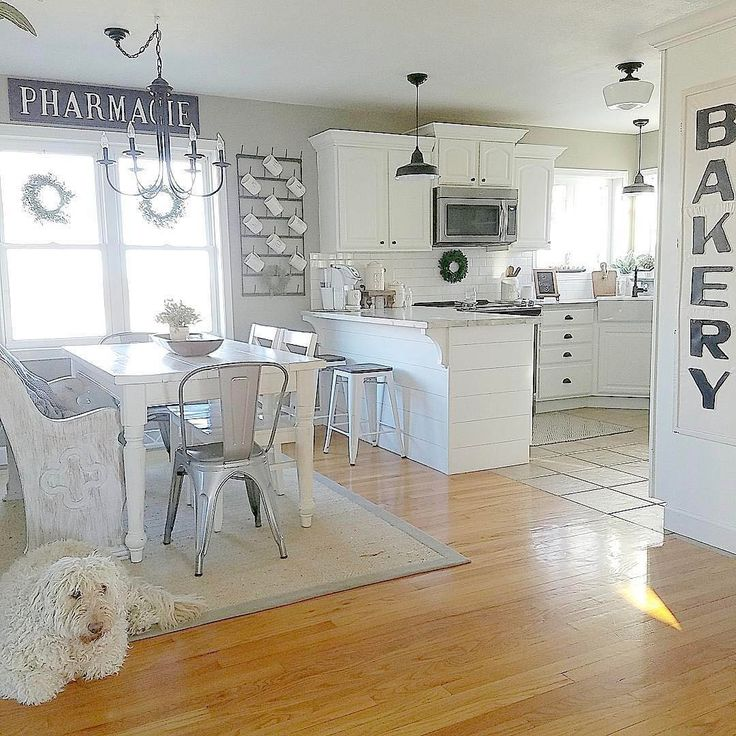 Loving Erica's bright white #kitchen, and her pup too! Thx for including our Bakery Sign in your #homedecor!