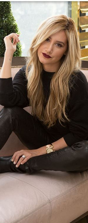 Who made Ashley Tisdale's gold jewelry, black sweater, and leather pants?