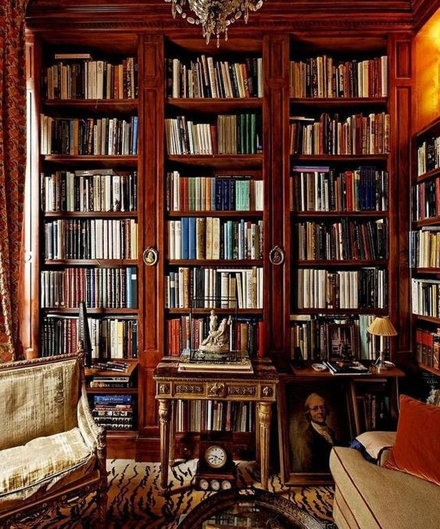 Old World Library With Brown Shelves And Brightly Colored Books