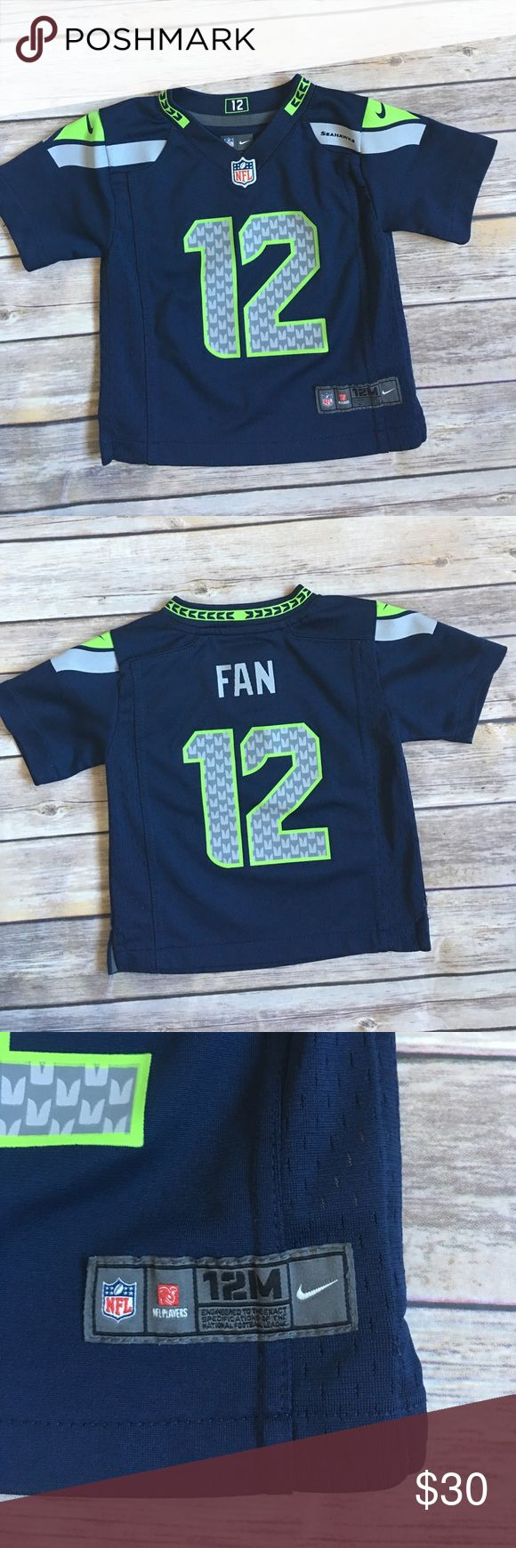 Authentic Seattle Seahawks Jersey Size 12 months Seahawks 12th Man Jersey.  Good condition, no stains, see photo above threading is loose on lower split (nothing that can't be fixed!) Shirts & Tops