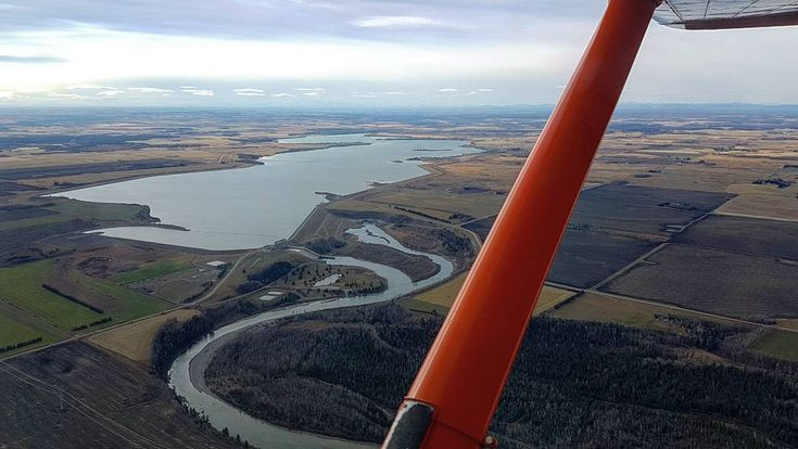 "As stressful as my job can be, it's tough to call flying ""work"" when you get views like this.  Manmade Glennifer Lake created in the middle of farmland by the Dickson Dam. Southwest of Red Deer, Alberta.  Been flying around here for four years now and I've never gotten over the name ""Glennifer."" 😂"