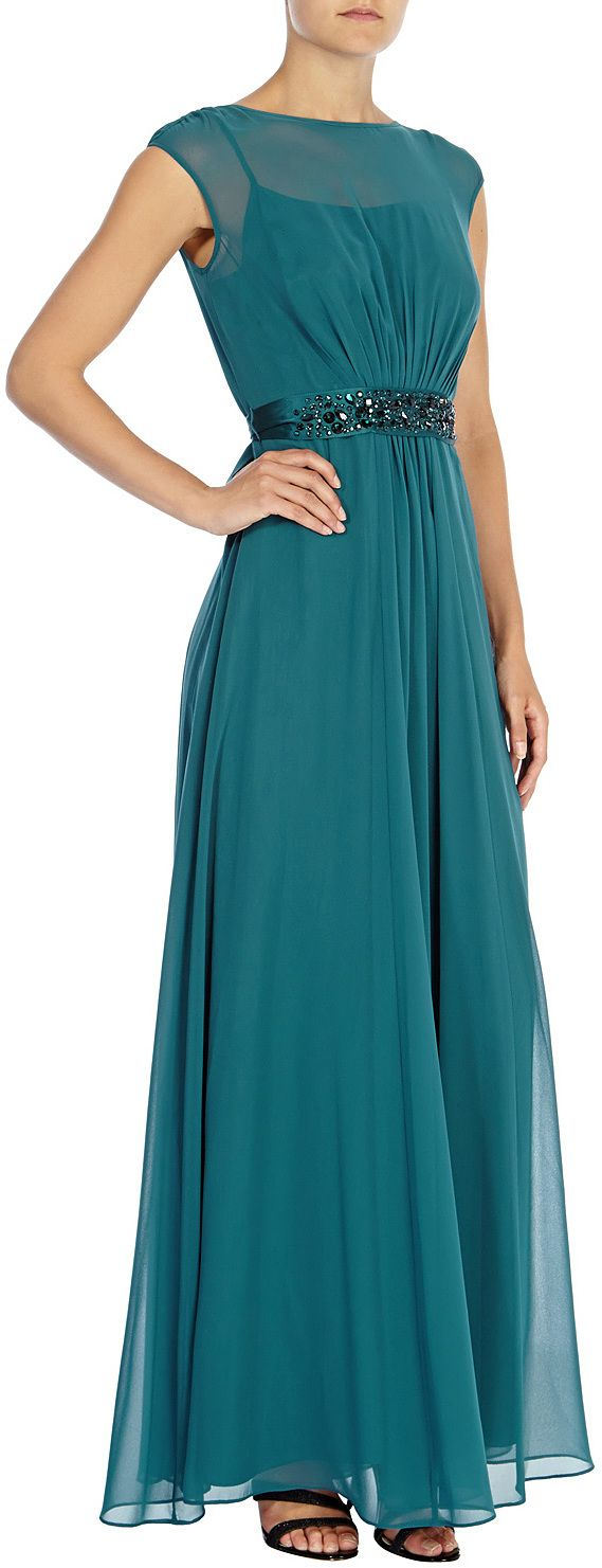 Coast Teal A truly sumptuous maxi gown perfect for any extra special occasion. The Lori Lee Maxi Dress features a sheer bodice lined with a soft slip for a demure and feminine allure. The waist is cinched with a lustrous waist tie embellished with faux gems for an opulent aesthetic. The back of the dress features a graceful keyhole detail and the skirt is fully lined for party perfect movement- £185 at ClothingByColour.com