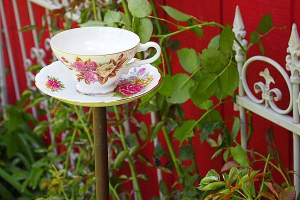 How to make a teacup birdfeeder - it's easy! This would be so sweet done in different heights and grouped as a flower garden trellis for morning glories or sweet peas too!