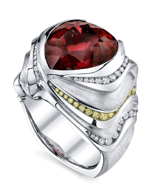 Platinum gents ring featuring a 15ct shield shaped rubellite tourmaline, accented with 0.90ctw of white diamonds and 0.225ctw of yellow diamonds. This piece is available for reproduction. Contact us t