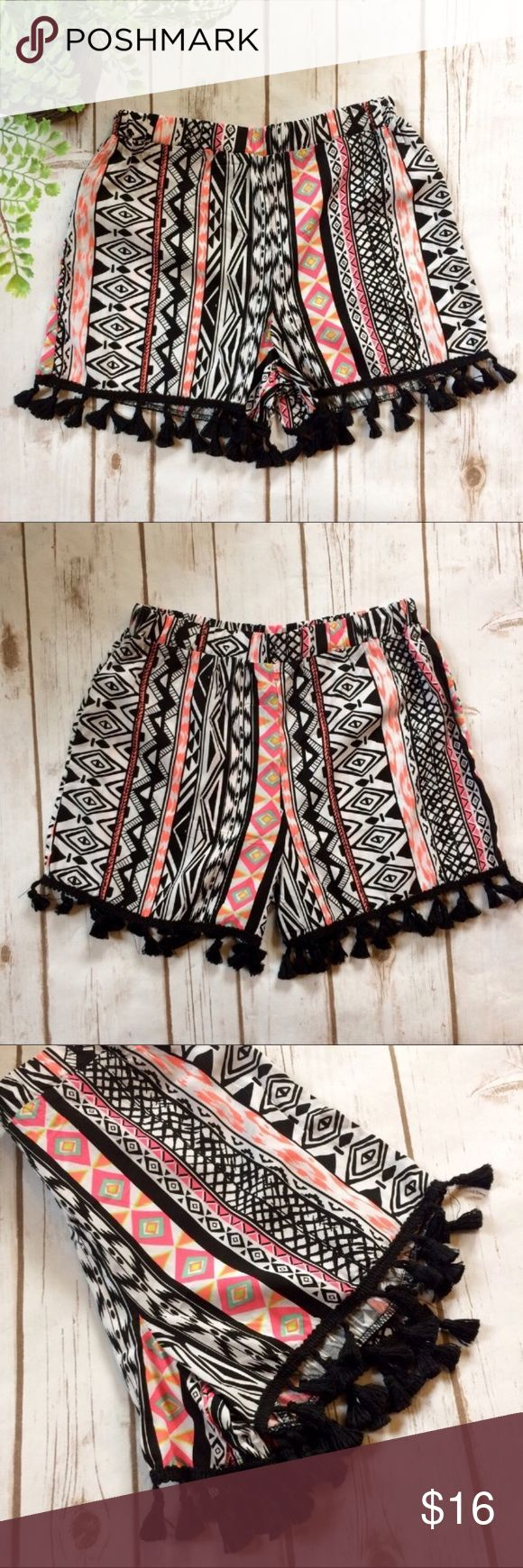 "🌼Festival Ready🌼 Aztec Fringe Shorts NWOT - fun, bright, Aztec Print shorts with black fringe. Features an elastic waist that stretches from 23""-30"". Inseam is 2.5"". 100% Rayon. Xhilaration Shorts"