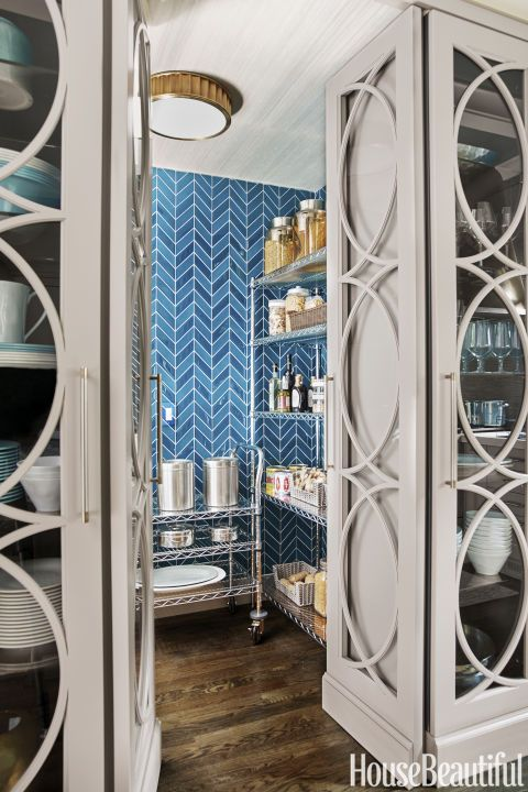 Since the pantry is visible from the home's entry, Quinn fancied it up with…