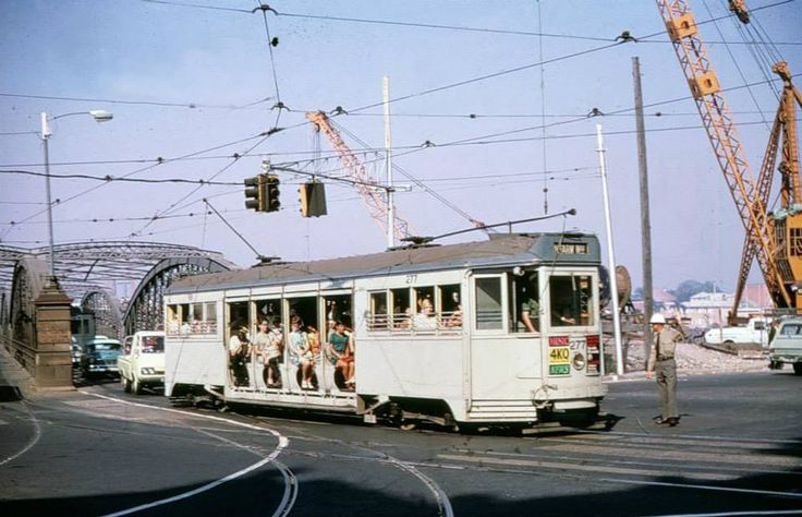 Tram entering Queen Street from the Victoria Bridge, 1960s. New Victoria Bridge under construction. — in Brisbane, Australia.