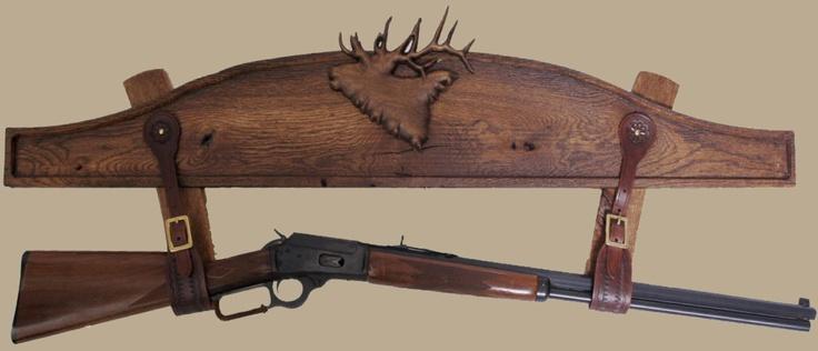Raging oak gun rack with leather straps