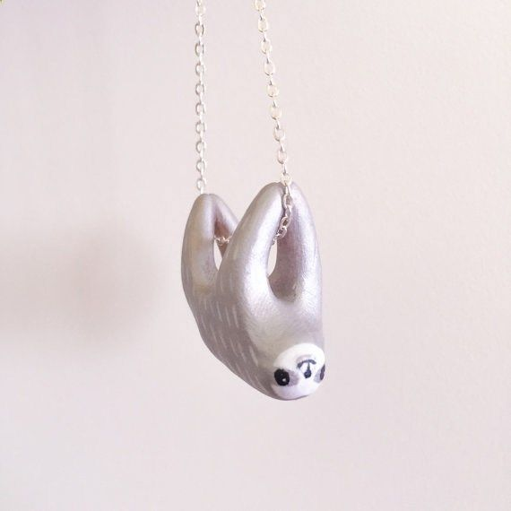 the humble sloth has never been so adorably glamorous! This metallic silver sloth necklace is handmade with polymer clay, and 20% of sale proceeds will be donated to #makeforgood on Etsy, funding vital projects for Plan, International. Silver Boy. Sloth Necklace with Hand Sculpted by YellowTreeStore