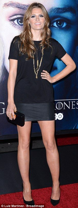 Leggy: Castle star Stana Katic was leggy in a very short mini skirt and basic black T-shirt combination