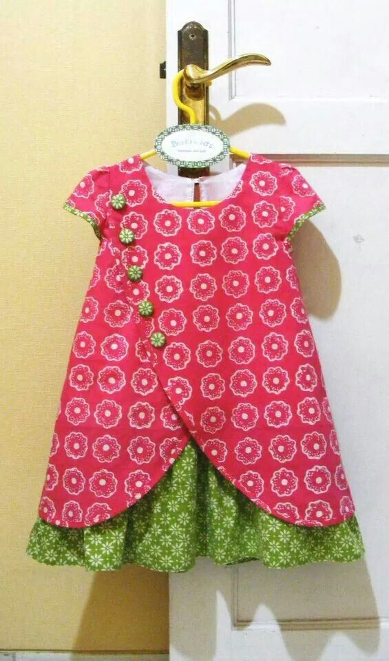Would love to see a similar pattern for women. I love the crossover, buttons and ruffled underskirt.  Batikids
