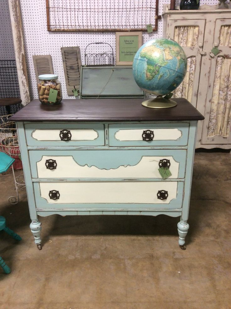 Minty blue 4 drawer chest with white accents. Top has been stained with Java Gel